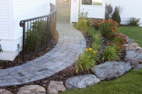 flower bed, boulders and pavers